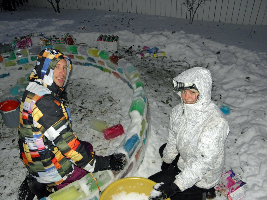 All bundled up, working diligently on their creation.