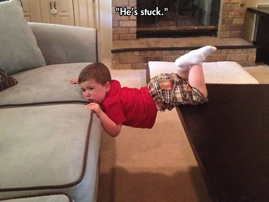 funny-baby-crying-stuck-couch-table