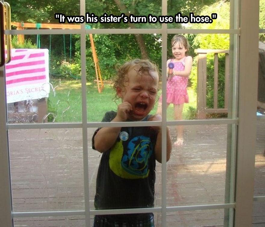 funny-baby-crying-window-water-gun