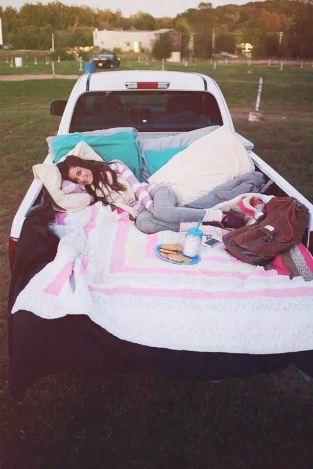 For our anniversary Gordon surprised me with a night at the drive in movie theatre. We took his truck and he threw blankets and pillows in the back and packed chai tea and pbjs and cookies. He is the sweetest. Cute date night ideas. Anniversary date night. Cami wade photography