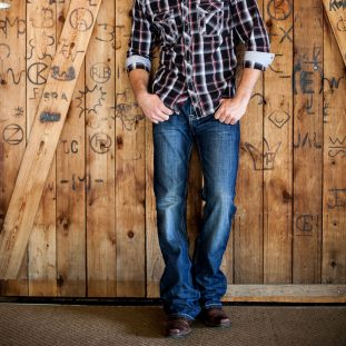 plaid shirt and cowboy boots